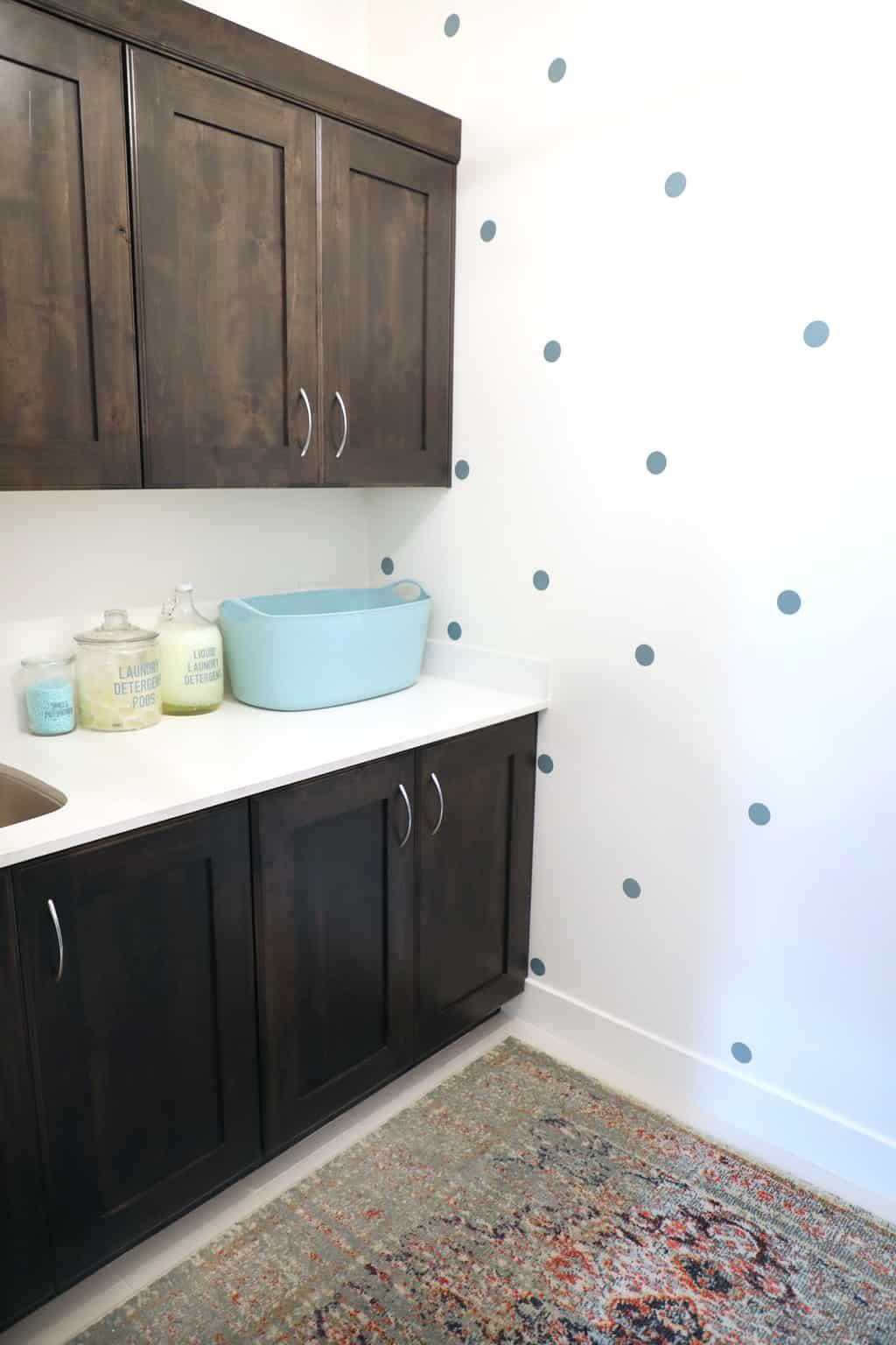 diy polka dot wallpaper in small laundry room