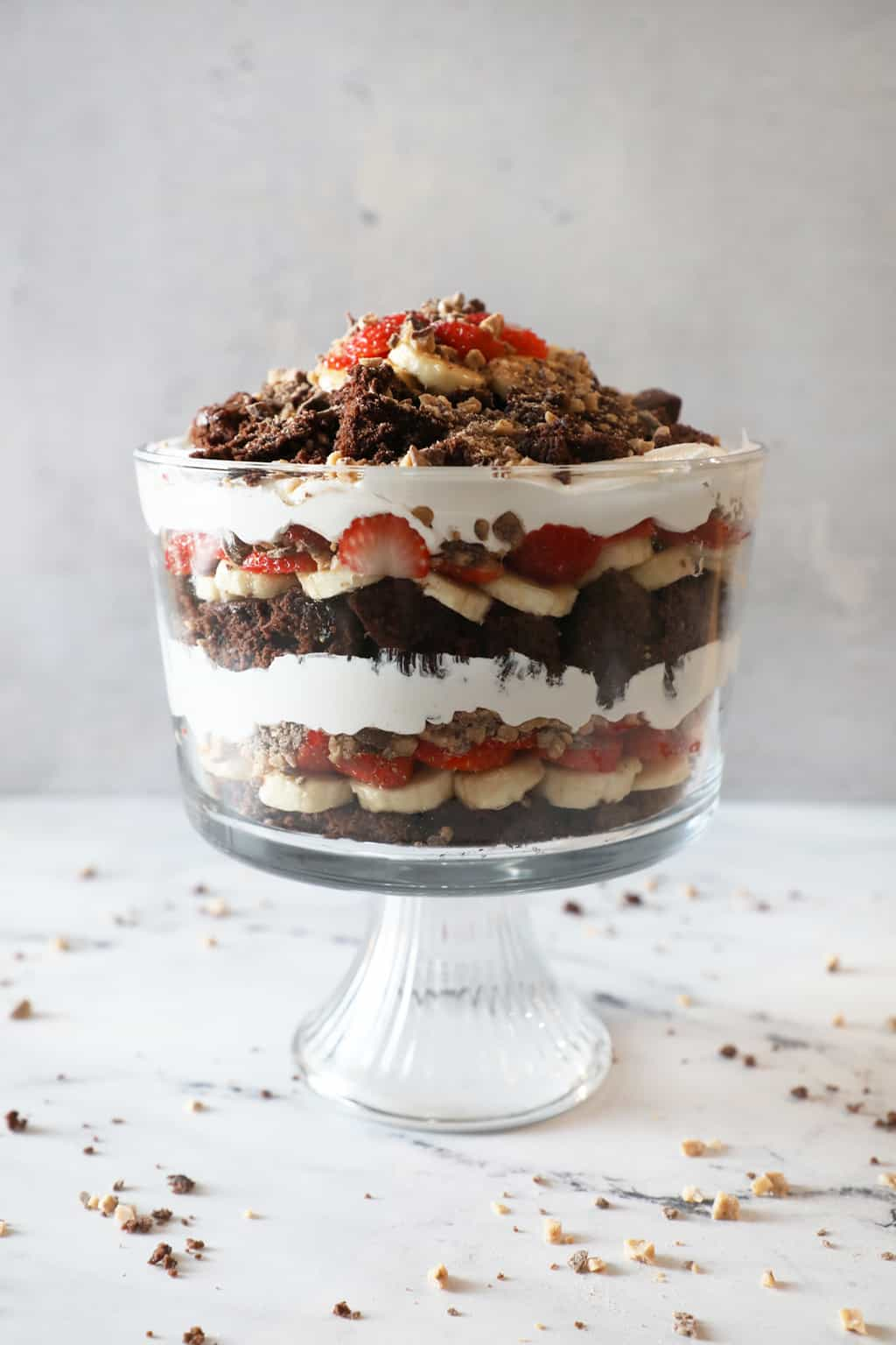 layers of brownie, banana, strawberry, heath bar and whipped cream in trifle dish