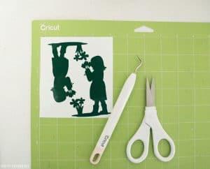 Weeded vinyl images on green cricut mat