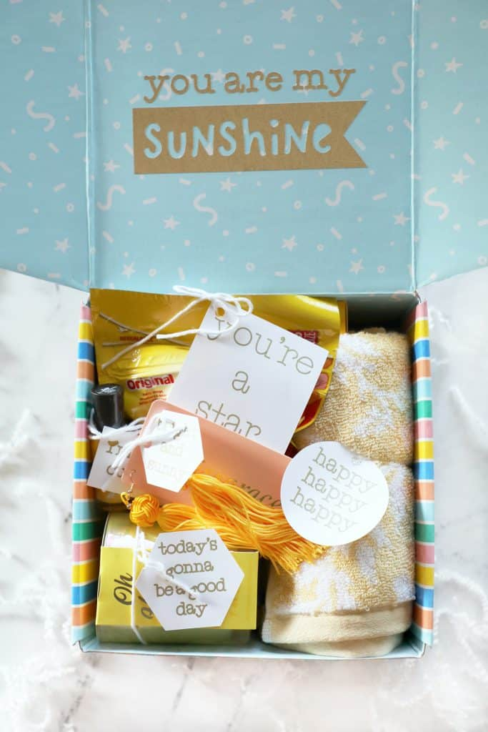 """close up image of a """"box of sunshine"""" gift idea on a white countertop"""