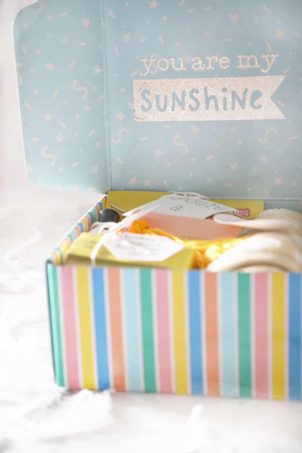 """box that has """"you are my sunshine"""" on the blue inside of the lid"""