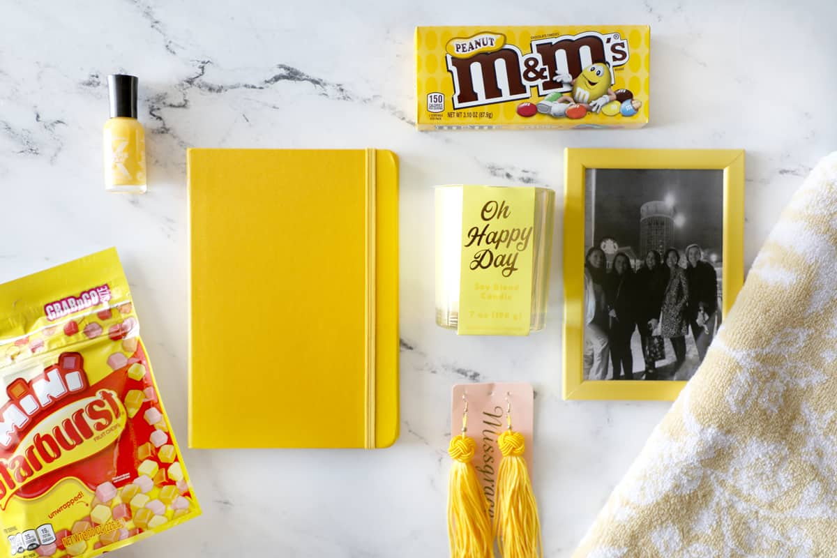 a bunch of yellow gift ideas arrayed on a granite countertop