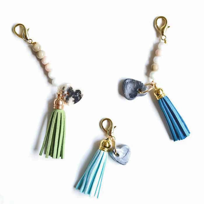 DIY keychains with beads, tassels, clay hearts with thumbprints in them