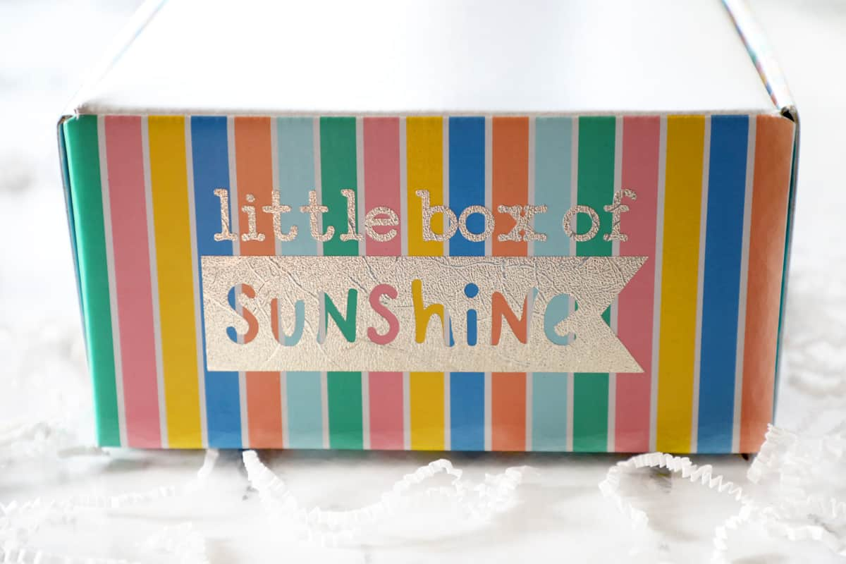 closed little box of sunshine rainbow colored on a white counter