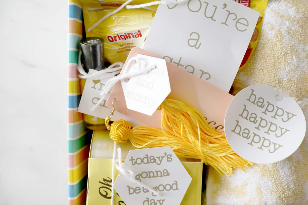 close up of yellow gifts with diy tags in a box