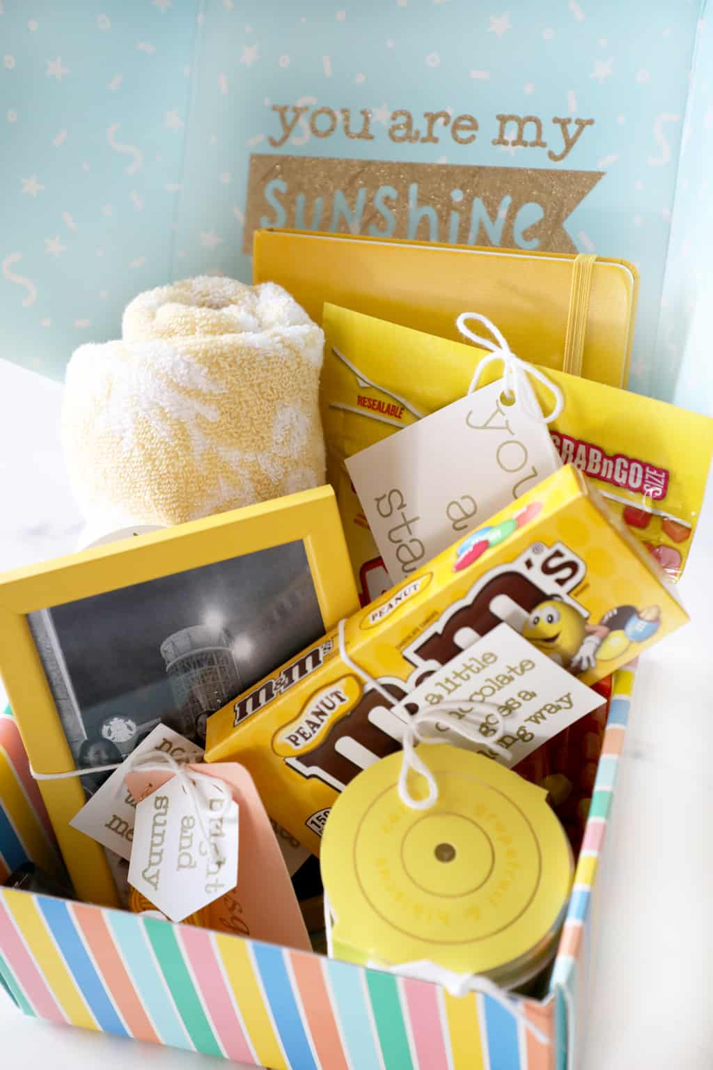 box that says you are my sunshine full of yellow gifts