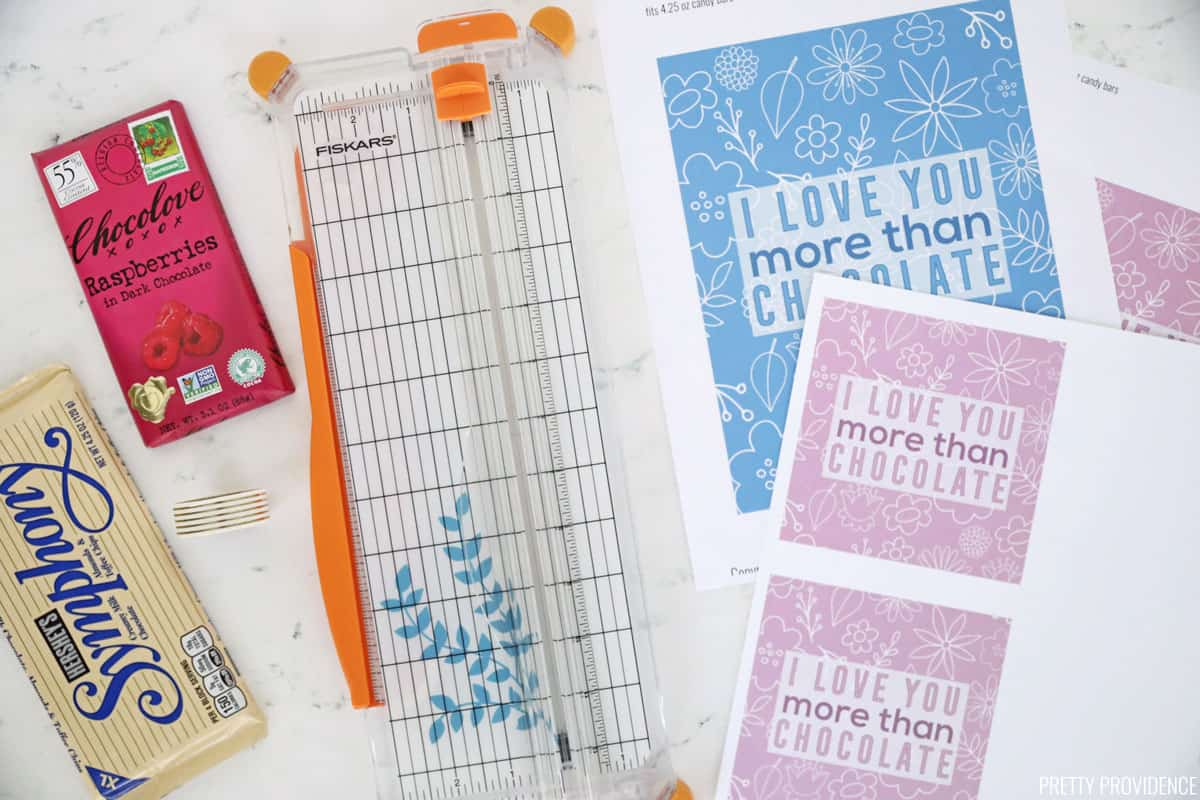 Candy bars, a fiskars paper cutter and printed gift tags for chocolate