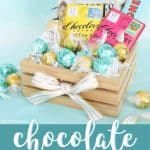 Chocolate Gift basket with truffles and chocolate bars, white bow on the front of the basket