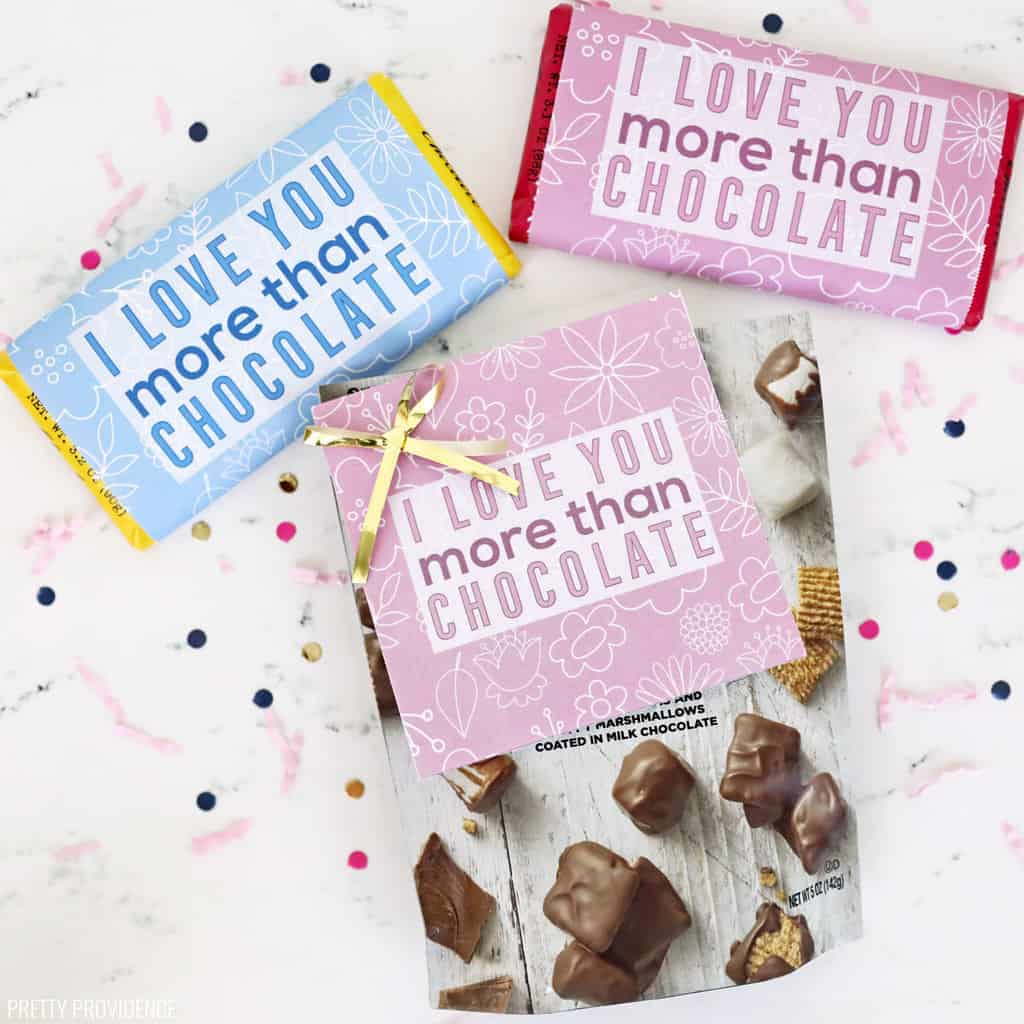 Two candy bars and a bag of chocolate candy with printable gift tags