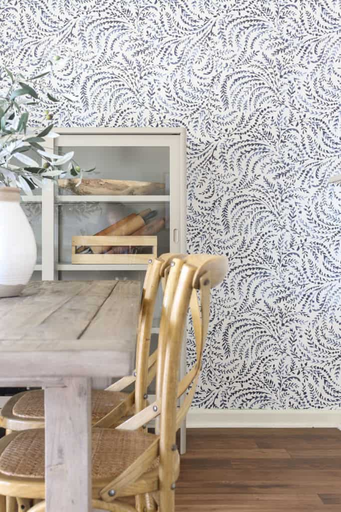 Wallpaper in dining room with shelf and table
