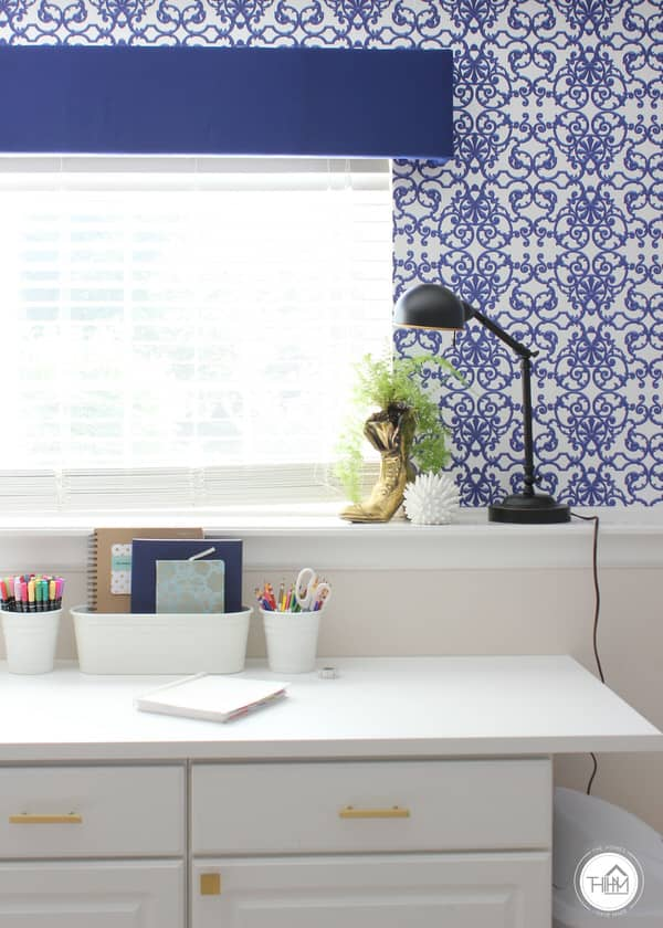 Blue Wallpaper and valance over a window with white craft desk