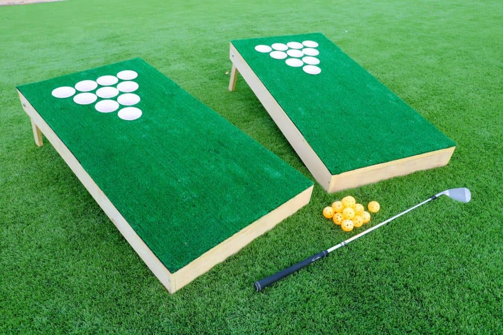 DIY Backyard chip shot golf game boards with turf, golf balls and golf clubs