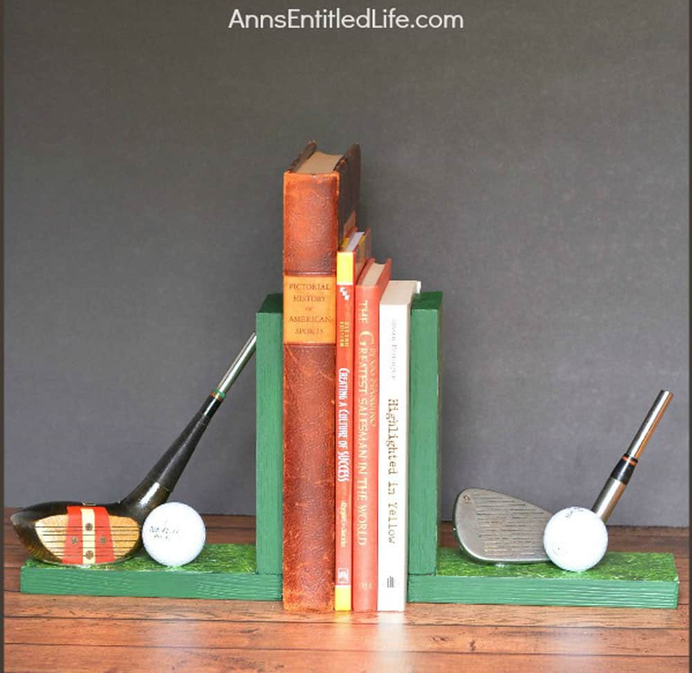Golf bookends with golf balls and clubs attached to them