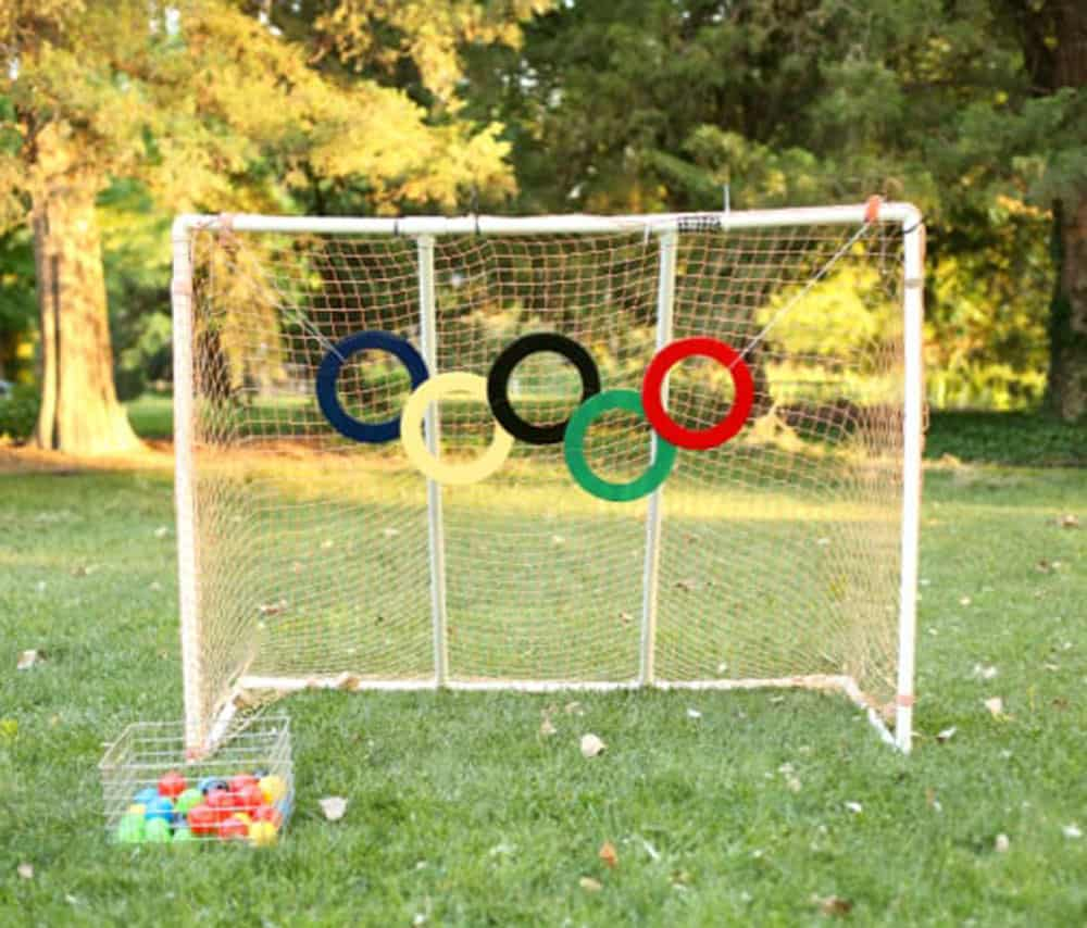 Olympic Rings Ball Toss Game with soccer goal on the grass