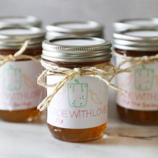 a small group of pint sized mason jars with diy labels