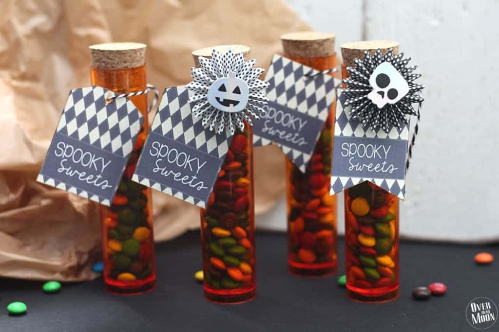 Spooky sweets tags on test tubes full of candy for Halloween
