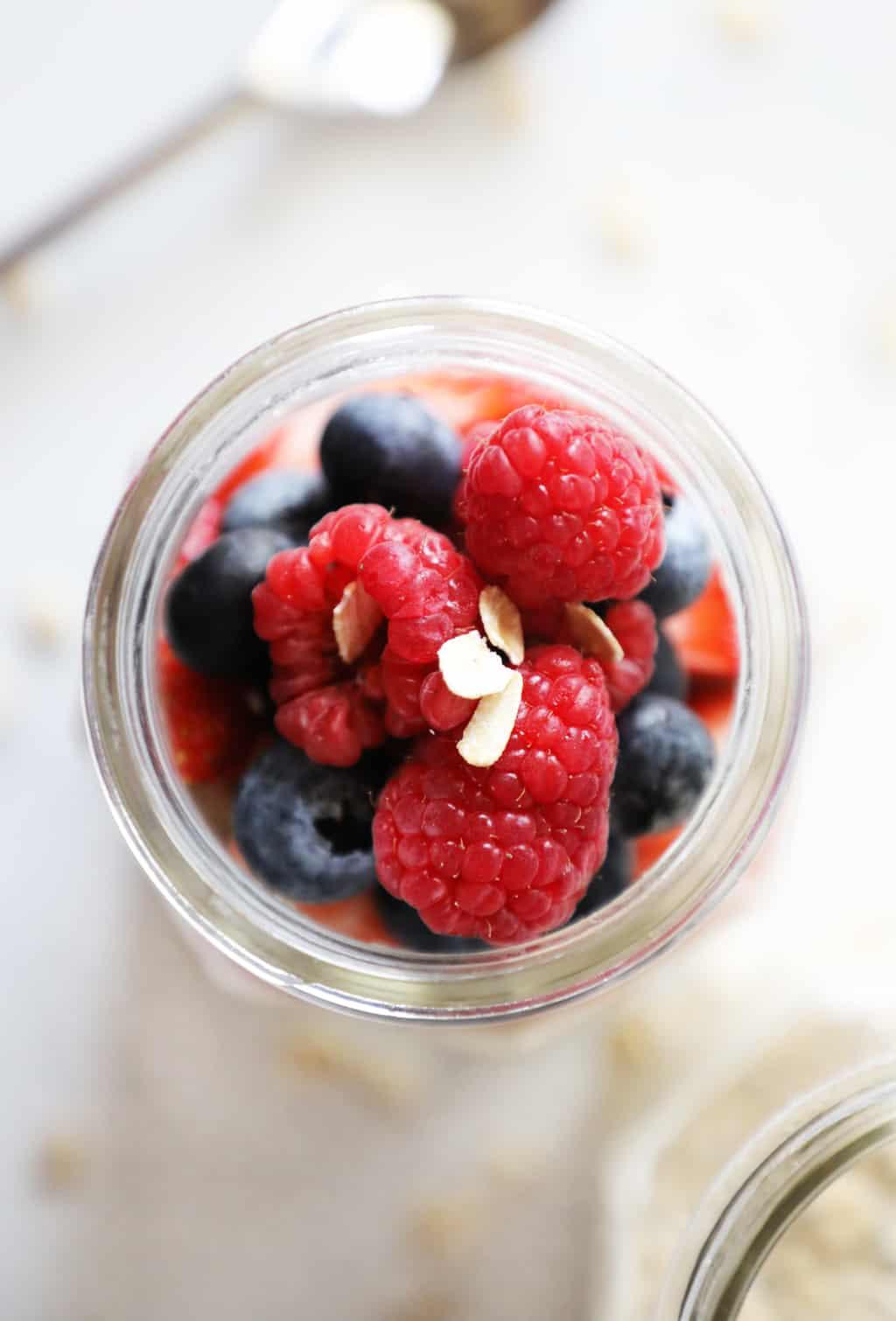 birds eye view of berries in a mason jar