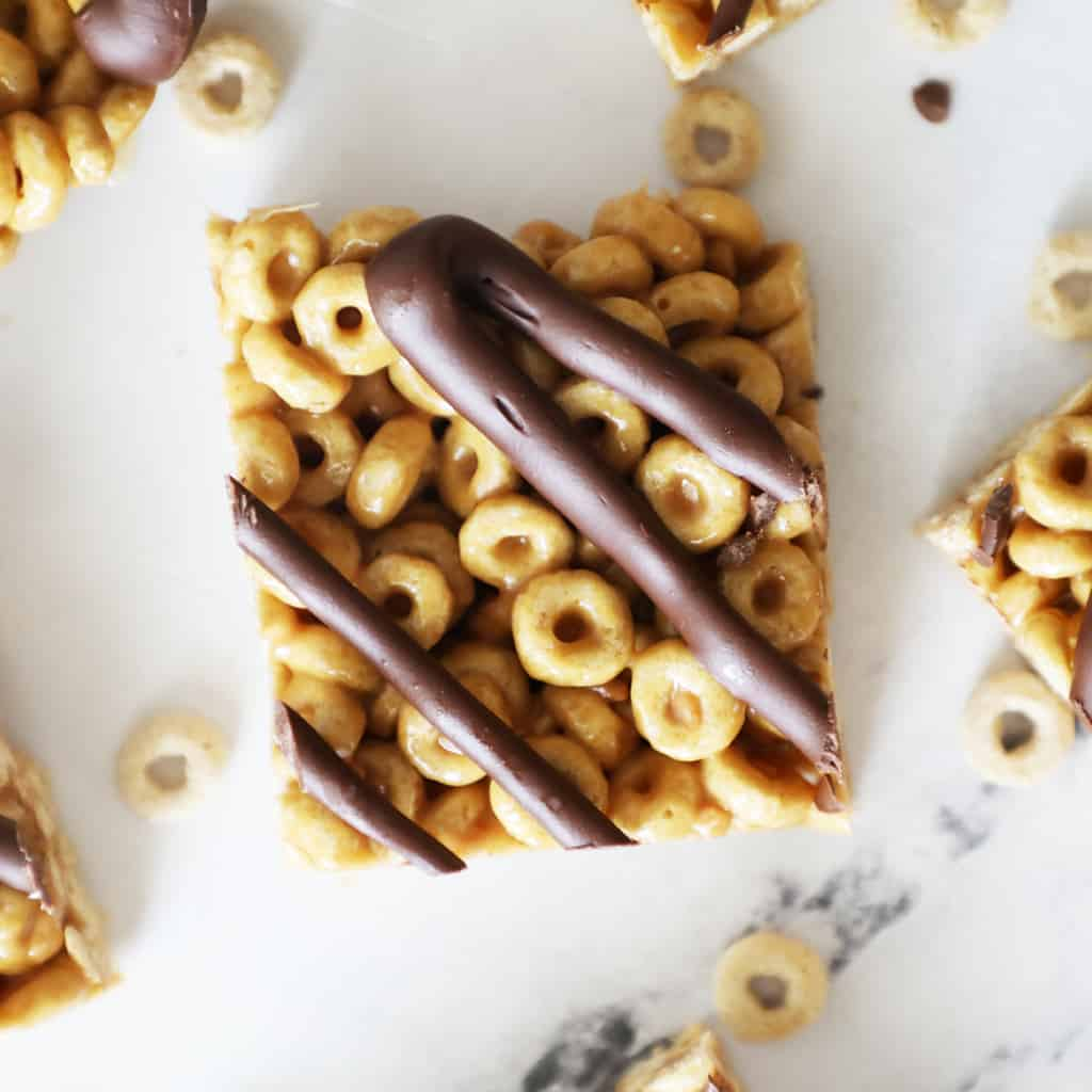 a cheerio bar with chocolate drizzled on top