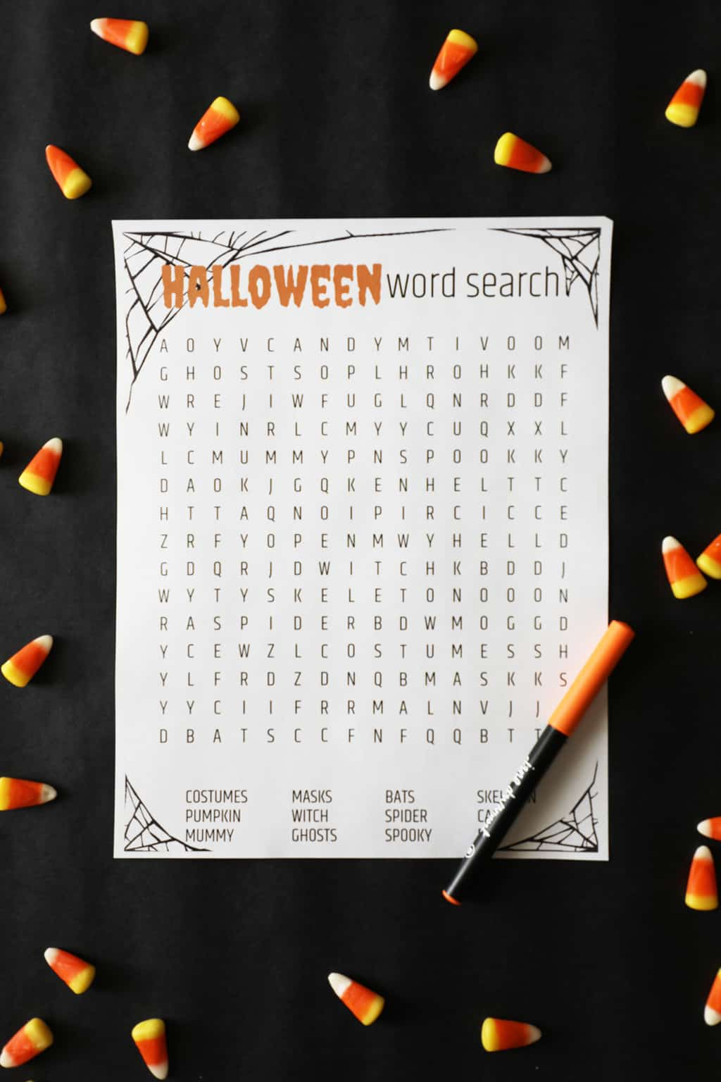 a free printable halloween word search with candy corn around it on a black background