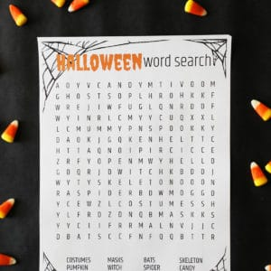 a halloween printable game on a dark background surrounded by candy corn
