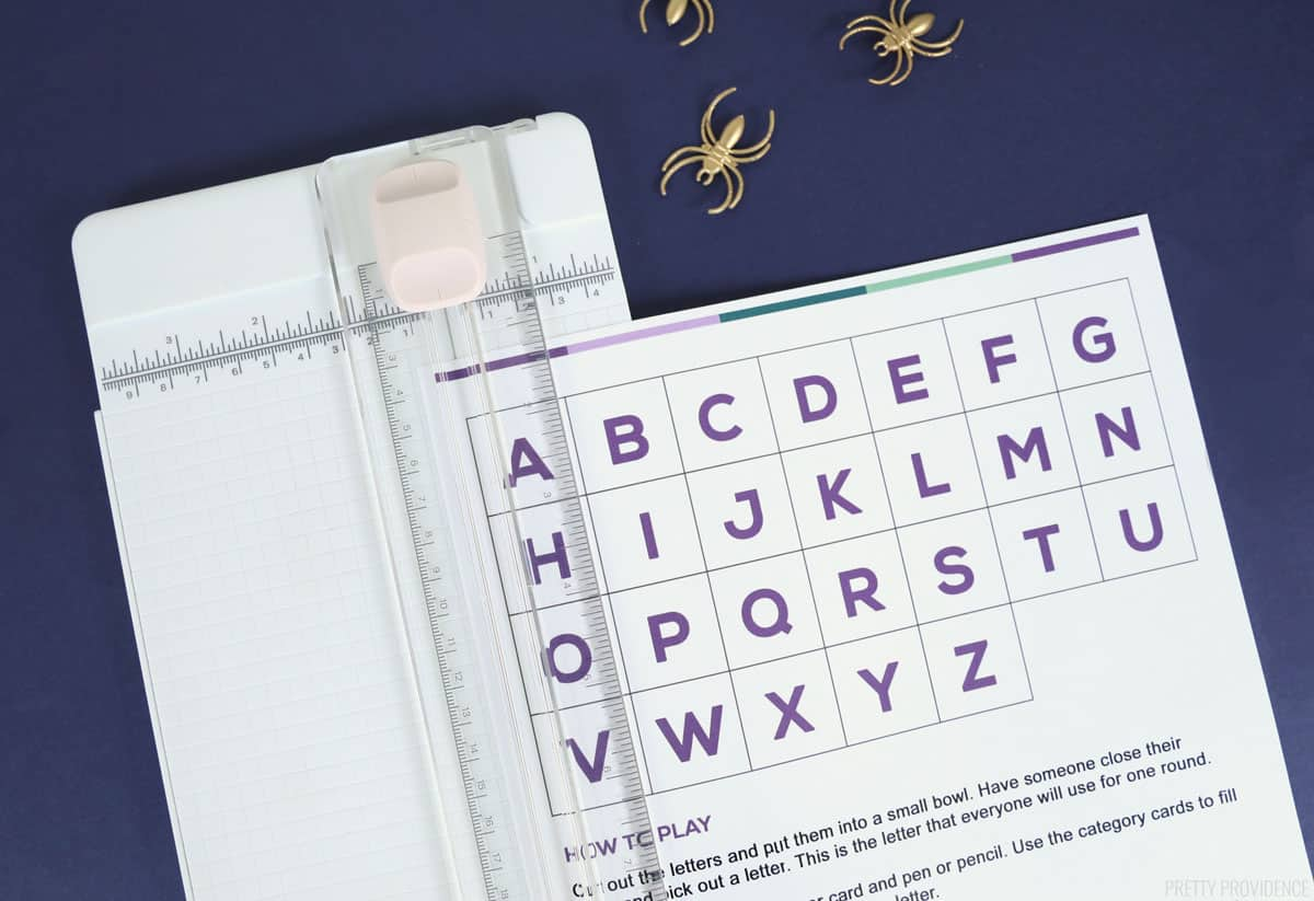 white paper with letters of alphabet in a paper cutter