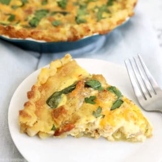 Leftover stuffing and turkey quiche on a white plate with fork