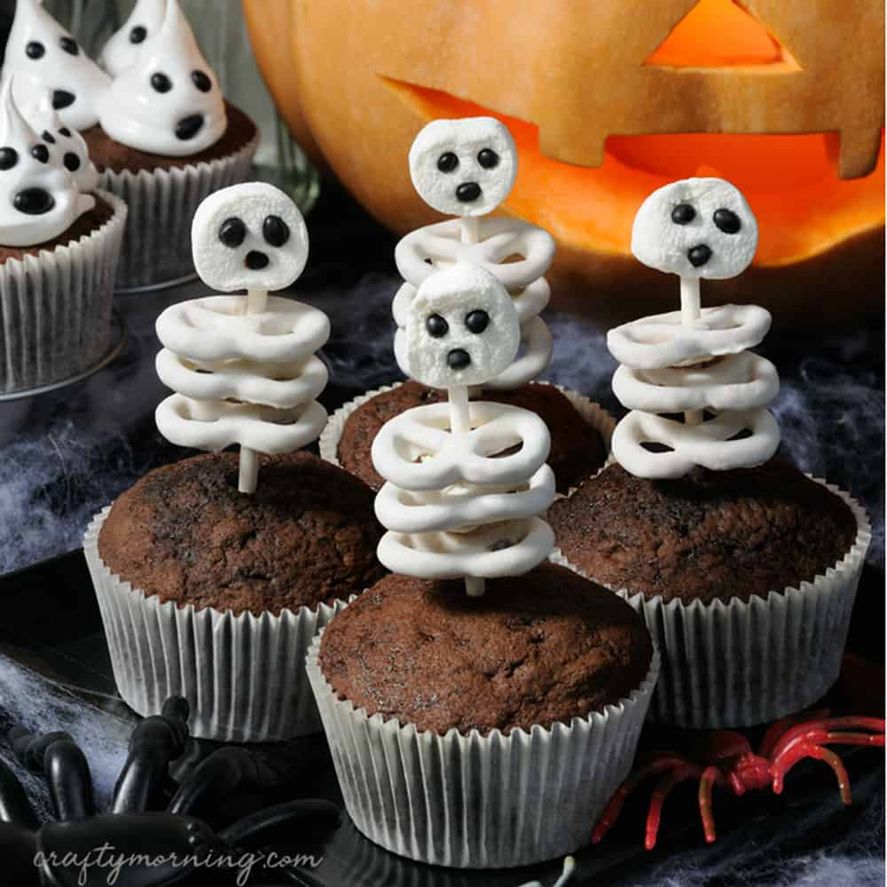 Skeleton cupcakes with skeletons made from pretzels and marshmallows