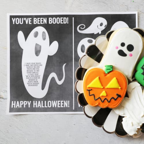 you've been booed printable with a black and white plate of treats on top of it