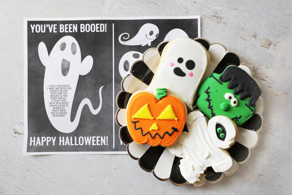 a plate of cute halloween cookies next to a halloween printable