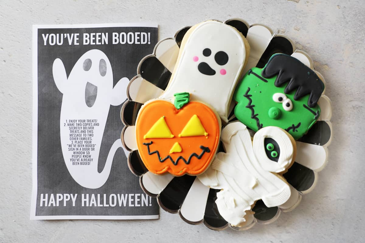 you've been booed printable next to a plate of cute halloween cookies
